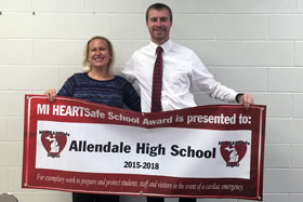 Athletic Trainer Jennifer Terpstra & Athletic Director JT Hogan honored with MI HEARTSafe School Award